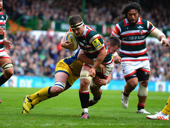 Tiger tackled: Will Evans is caught during an Aviva Premiership match.