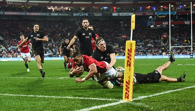 New Zealand All Blacks Inside Centre Conrad Smith R Cuts Through The Lions Defence