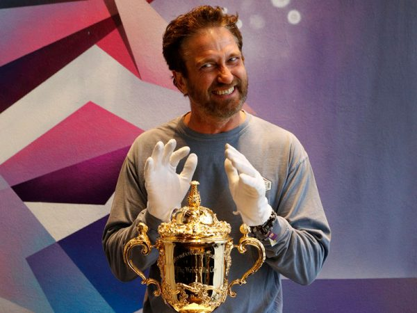 Gerard Butler Gets To Grips With Rugby World Cup Trophy