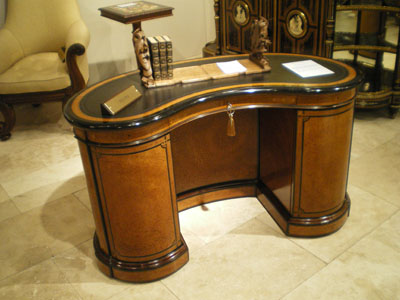 Curved library table by Gillows, with Butchoff
