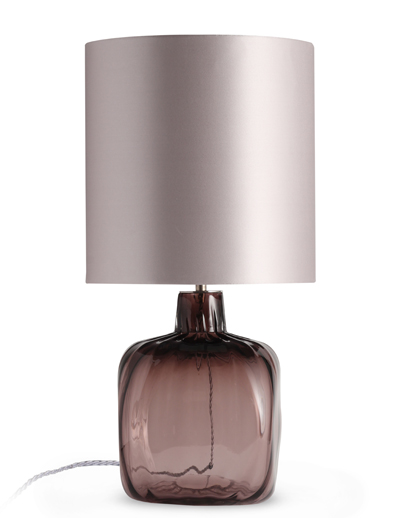 The Glass Base Of This Table Lamp Is Blown In A Transparent Colour And Has  A Delicate Ribbed Texture. It Is Topped By An Elegant Satin Shade In Warm  Grey.