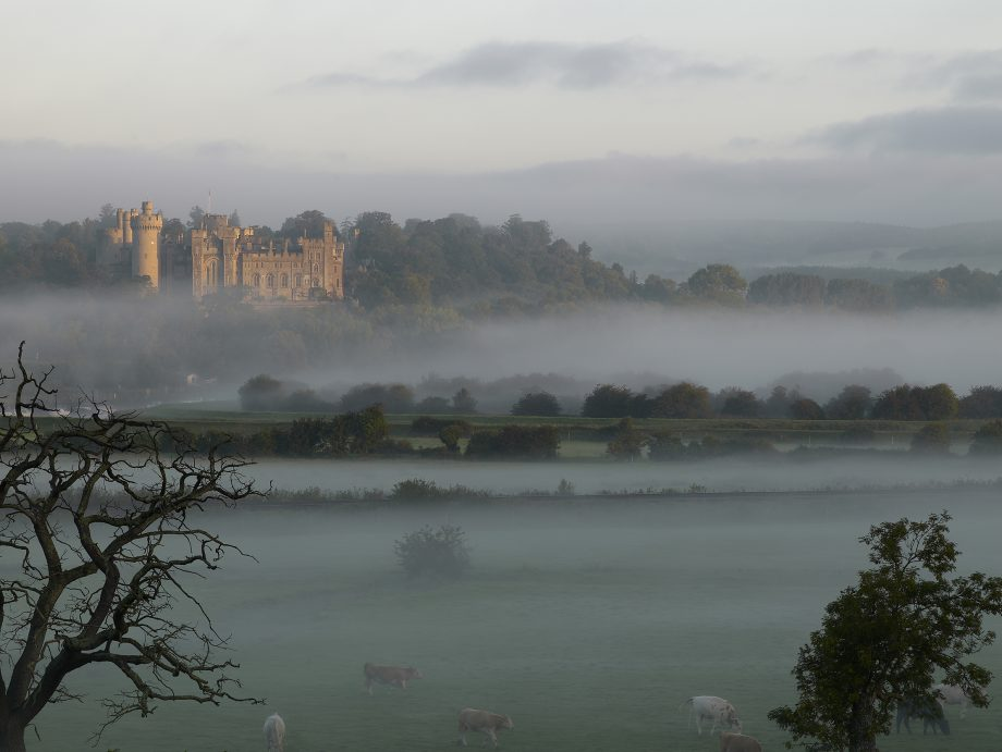 Arundel, shrouded in mistm seen from the plains below. ©Paul Barker/Country Life