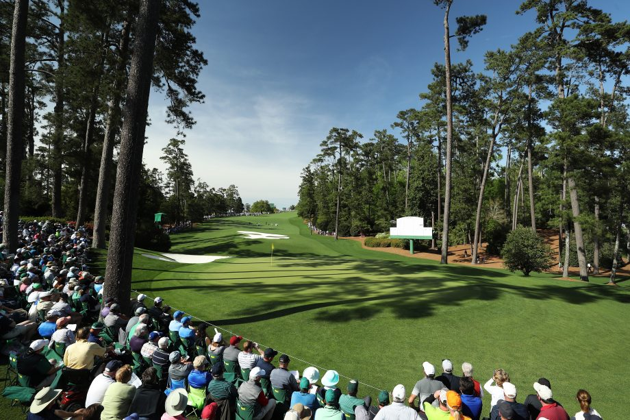 Patrons watch play on the tenth green during the first round of the 2018 Masters Tournament at Augusta National Golf Club. Photo by David Cannon/Getty Images.