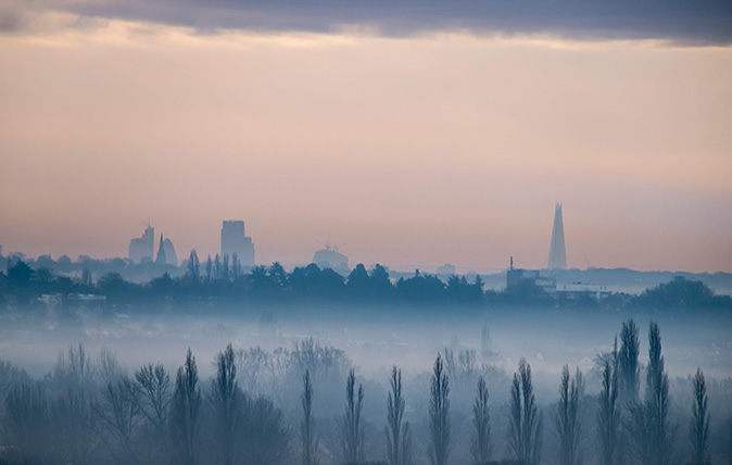 City of London in distance on misty morning