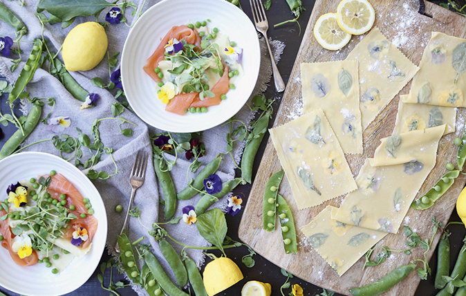 Basil and flower-pressed pasta with peas and salmon
