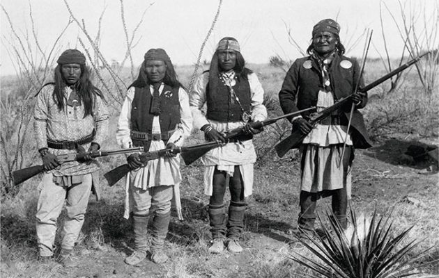 Apache chief Geronimo (far right) and three of his warriors with Winchesters
