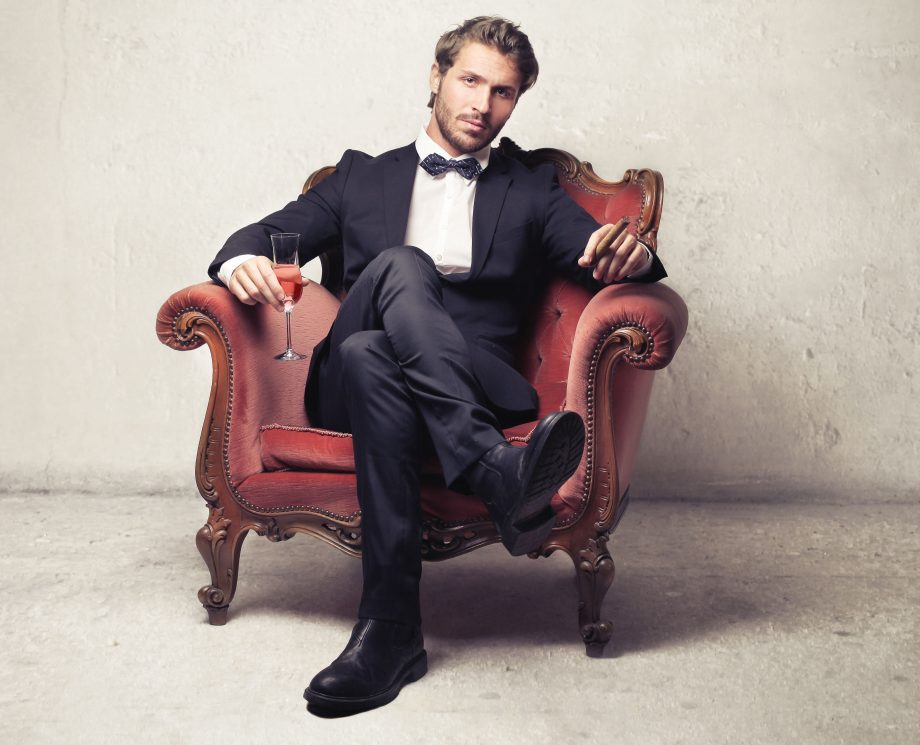 Gentleman sitting on a vintage armchair