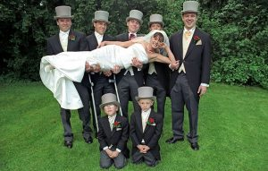 Morning suits and top hats at a wedding