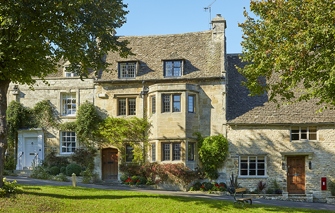an elegant cotswold town house with a pretty cottage at