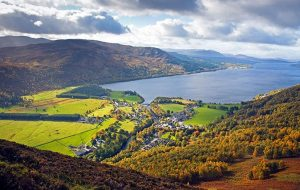 The village of Kinloch Rannoch and Loch Rannoch in the autumn viewed from Craig Varr