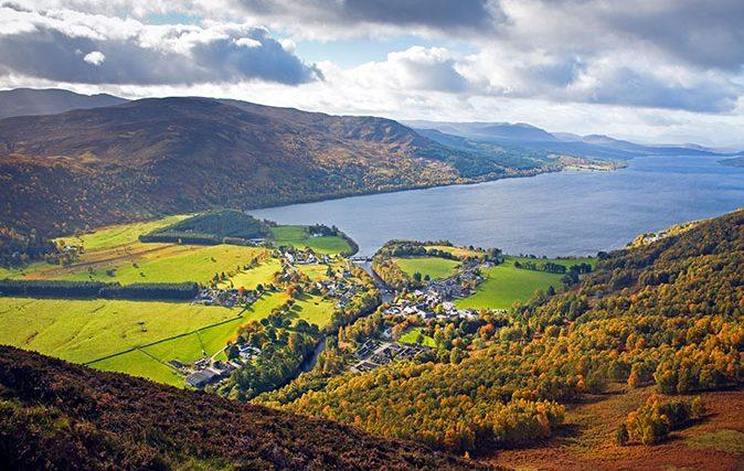 The village of Kinloch Rannoch and Loch Rannoch in the autumn viewed from Craig Varr