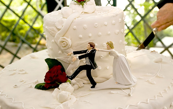 Wedding cake topper featuring bride and groom