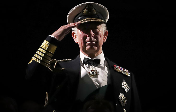 The Prince of Wales, known as the Duke of Rothesay in Scotland, takes the salute during the Royal Edinburgh Military Tattoo at Edinburgh Castle. (©Jane Barlow/PA)