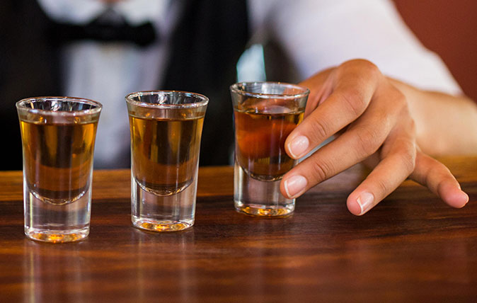 Tequila in shot glasses on a bar