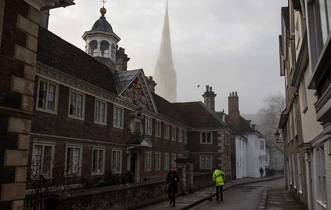 Salisbury Cathedral emerges from a morning fog in town centre
