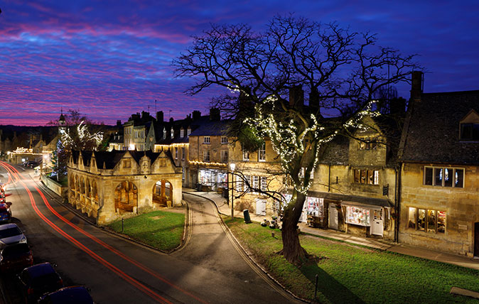 Market Hall and Cotswold stone cottages along High Street at dusk, Chipping Campden, Cotswolds, Gloucestershire