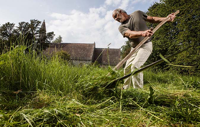 Scyther Nigel Adams in the churchyard at Pyrton Church, Oxfordshire. Pictures © Richard Cannon/Country Life Picture Library