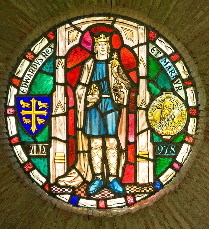 A stained glass roundel dedicated to King Edward the Martyr at Shaftesbury Abbey ruins in Dorset
