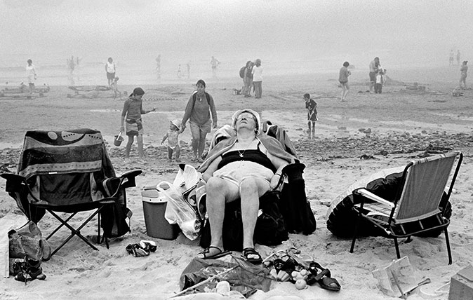 Porth Oer (Whistling Sands) - Enjoying the beach. 2004 ©David Hurn / Magnum Photos, and taken from the exhibition 'The Great British Seaside: Photography from 1960s to present' at the National Maritime Museum