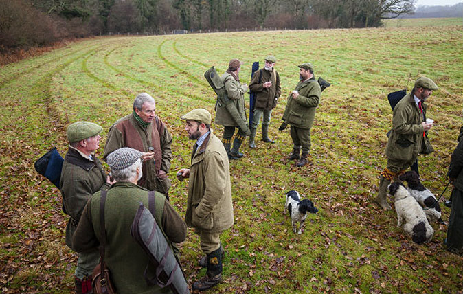 Men in tweed shooting coats