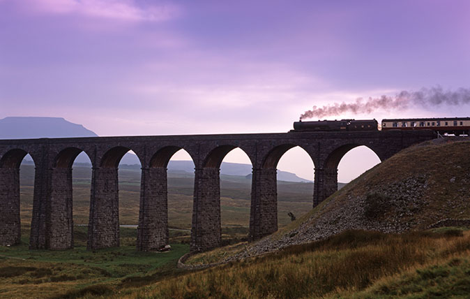 A steam train crosses the Ribblehead Viaduct in North Yorkshire.