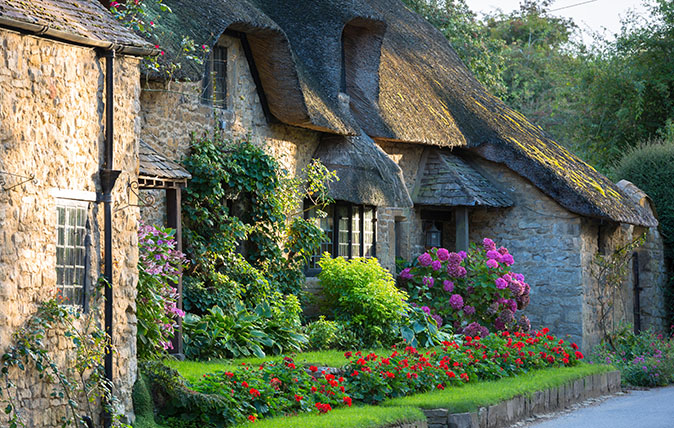 Quaint attractive traditional thatched country cottage at Broad Campden in the Cotswolds, Gloucestershire