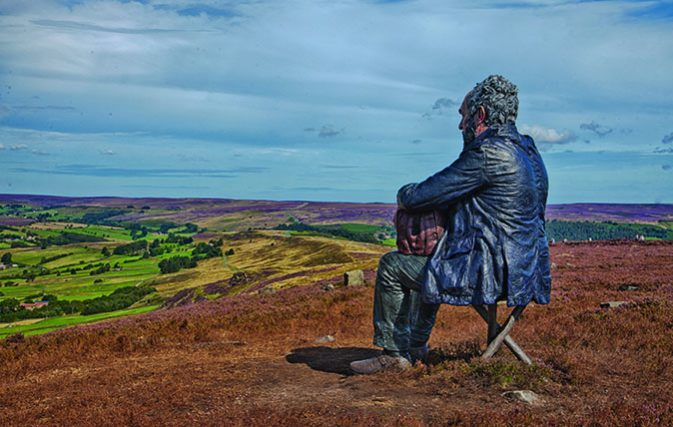 Seated figure on the North York Moors by Simon Penson