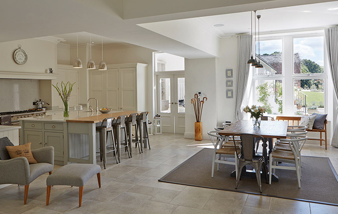Rugs, lighting and furniture can be used to zone a large room and make maximum use of its potential for cook- ing, dining, socialising and relaxing. Kitchen by Tom Howley (0161–848 1200; www.tomhowley.co.uk)