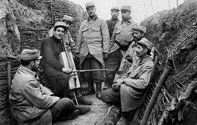 A soldier with a trench cello of the type used by by Harold Triggs, pictured in a French trench in 1914. (Photo by Neurdein/Roger Viollet/Getty Images)