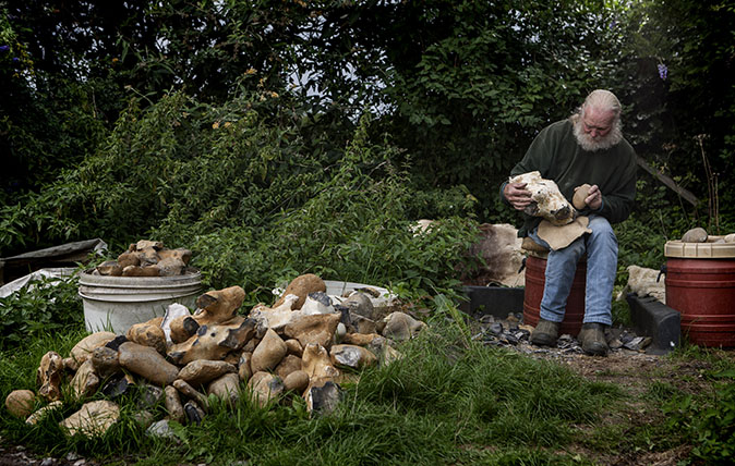The flint knapper: 'They used to make prisoners do it, but I do it for fun and manage to make a living'