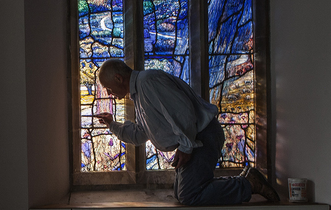 Tom Denny Stain Glass window maker. Photographed inside All Saints Church in Middle Woodford, Wiltshire. Photography by Richard Cannon on Friday 30th August 2018