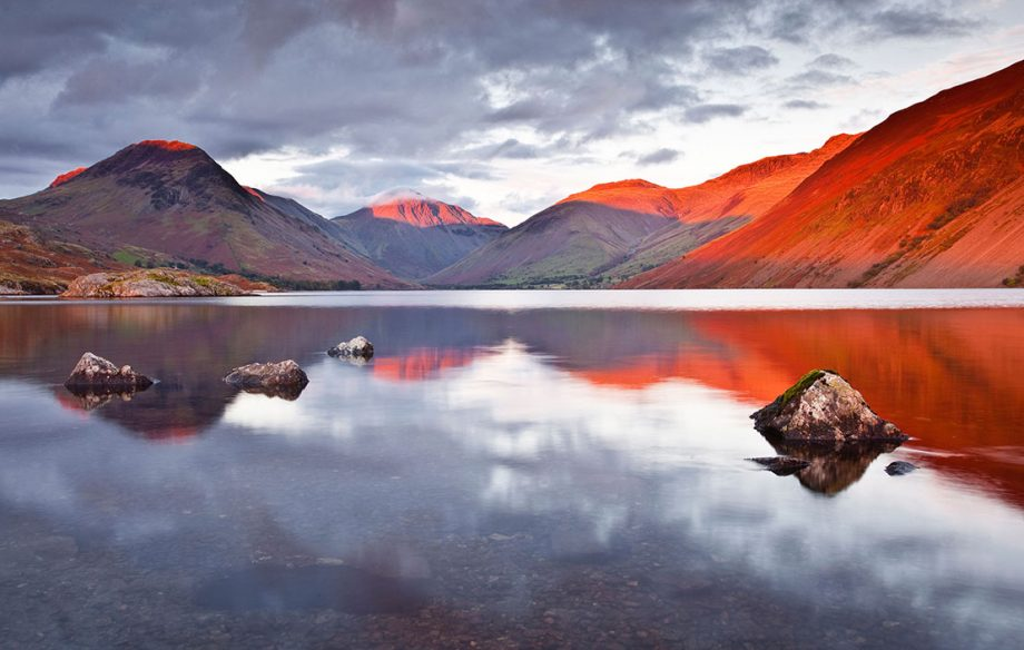 The Scafell range across the reflective waters of Wast Water in the Lake District National Park, Cumbria