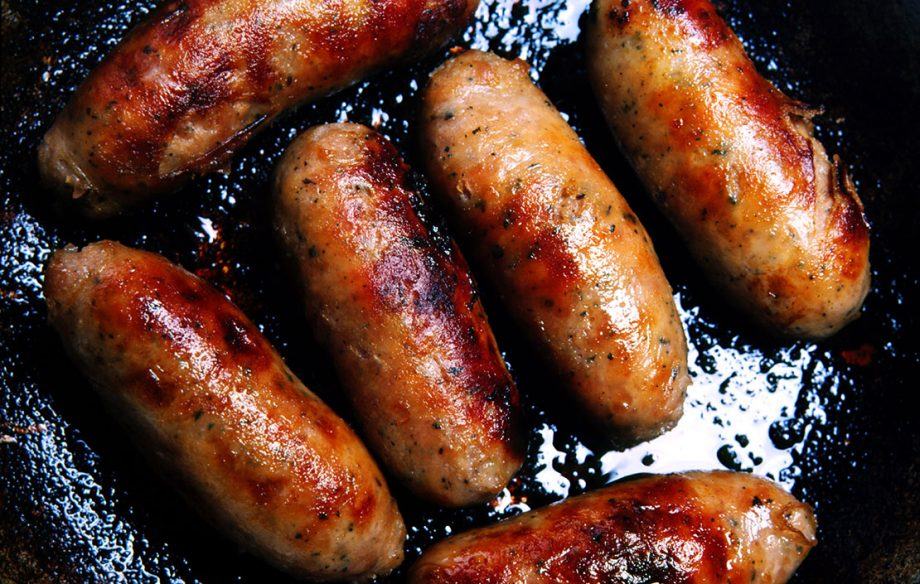Brilliant British sausages cooking in a frying pan