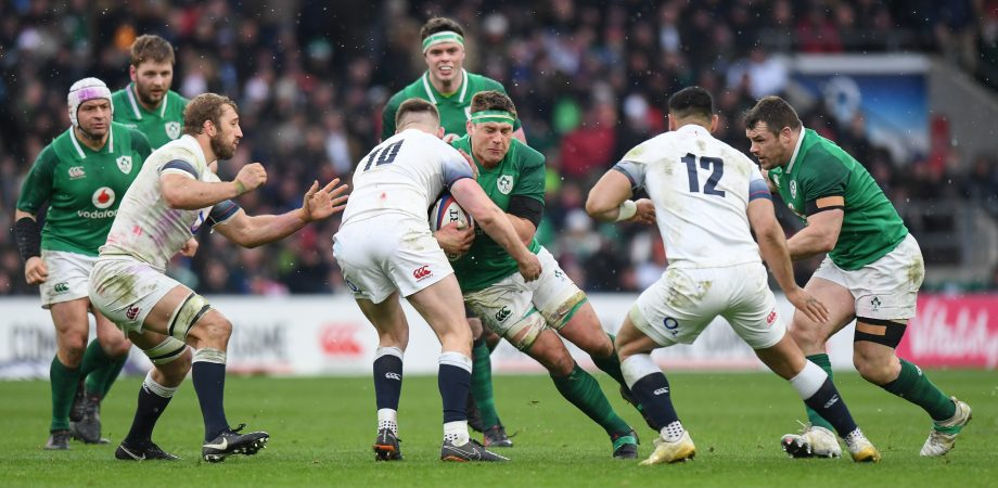 Ireland's CJ Stander is tackled by England's Owen Farrell