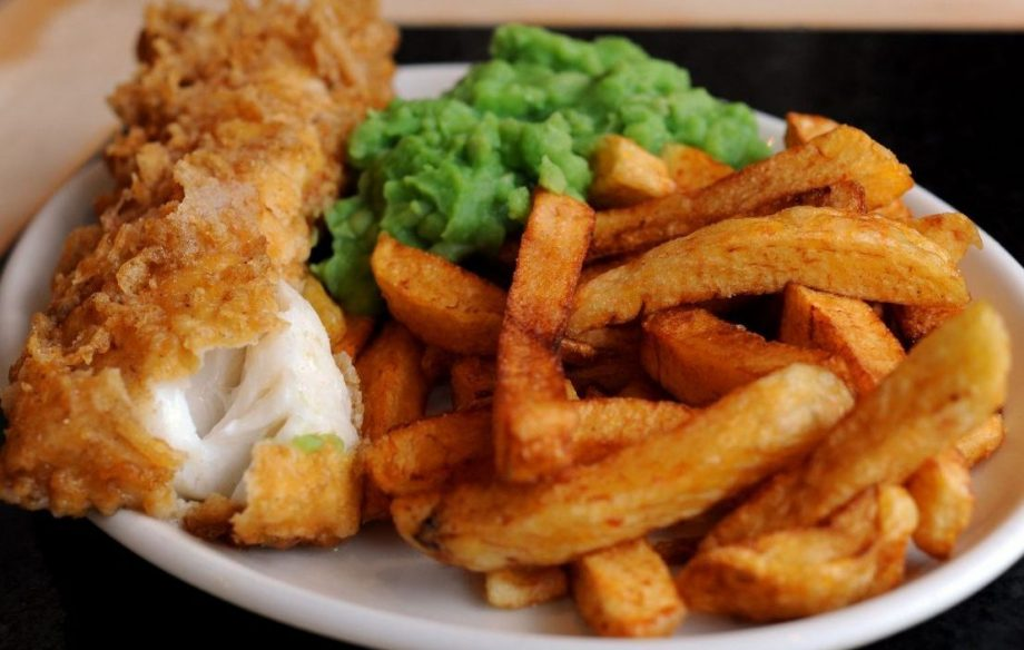 A plate of fish chips and mushy peas