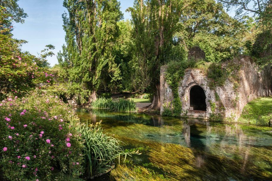 Ninfa, Lazio, Italy. The exceptionally clear water of the river flowing through this spectacular romantic landscape garden is a sight to behold.