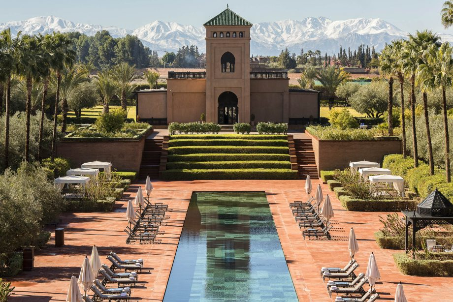 A view of the Selman Marrakech Hotel with the Atlas Mountains looming in the background.
