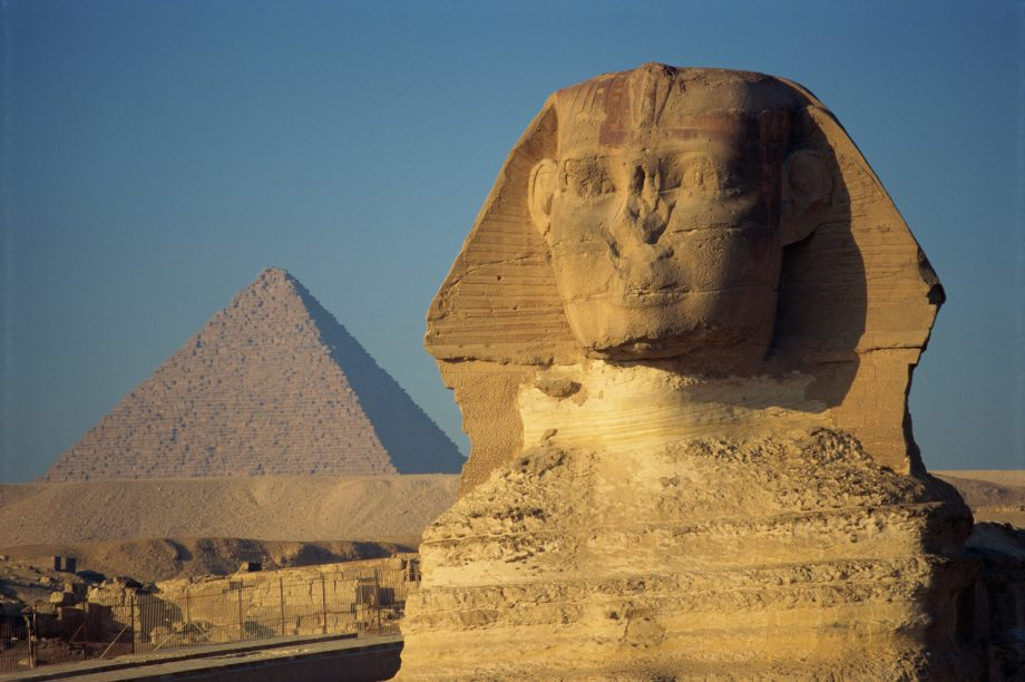 The Sphinx and one of the pyramids at Giza, Egypt.