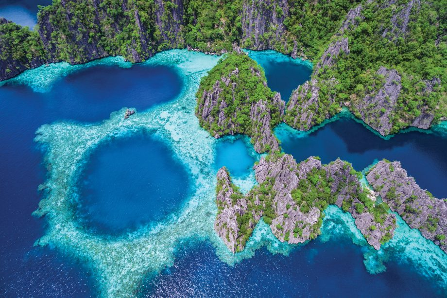 Banwa Island, Philippines. An aerial view of its beautiful lagoons and limestone cliffs.
