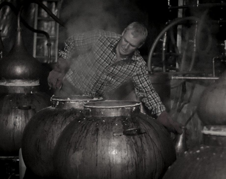 Dr John Walters hard at work distilling.