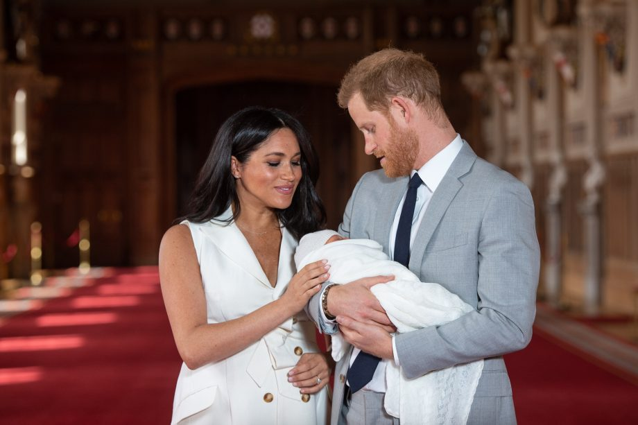 Prince Harry, Duke of Sussex and Meghan, Duchess of Sussex, pose with their newborn son during a photocall in St George's Hall at Windsor Castle on May 8, 2019 in Windsor, England. The Duchess of Sussex gave birth at 05:26 on Monday 06 May, 2019. (Photo by Dominic Lipinski - WPA Pool/Getty Images)