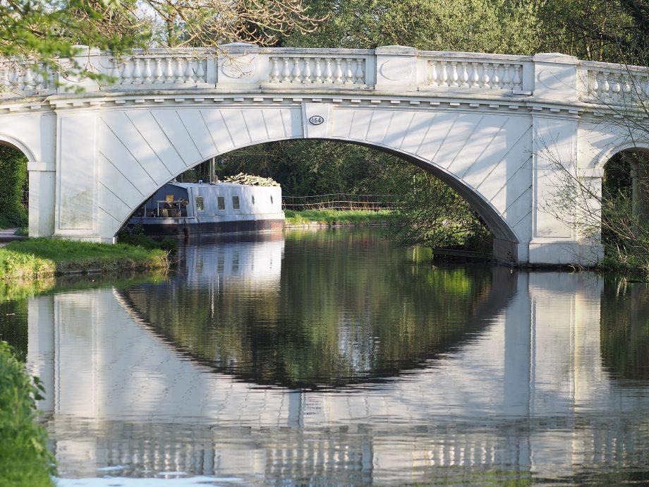 A white bridge over the Grand Union Canal.