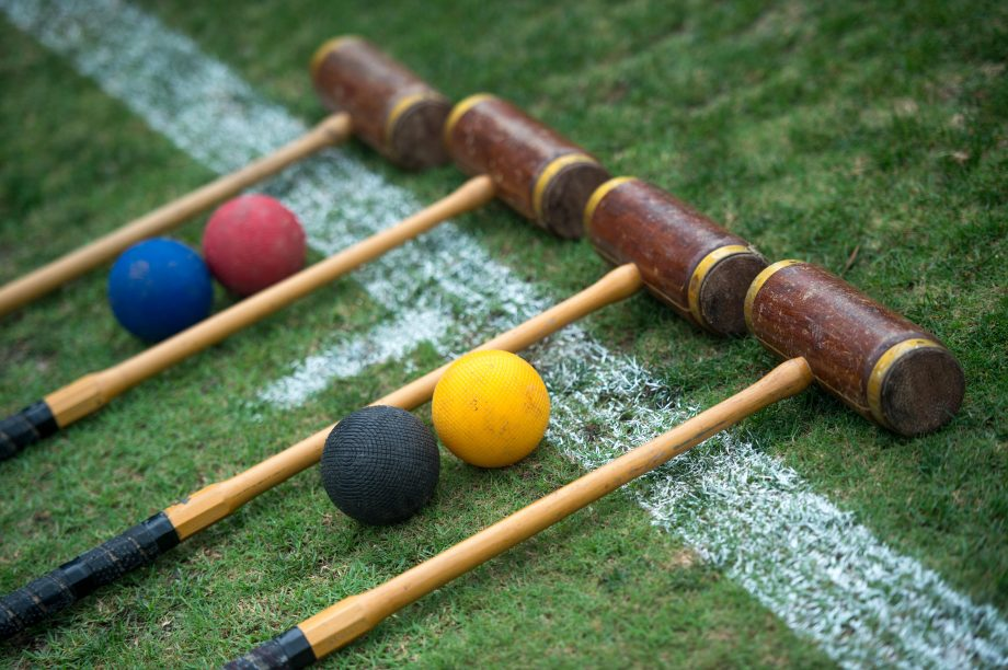Croquet set laid out ready to play, croquet mallets and balls.Jayne Russell / Alamy Stock Photo