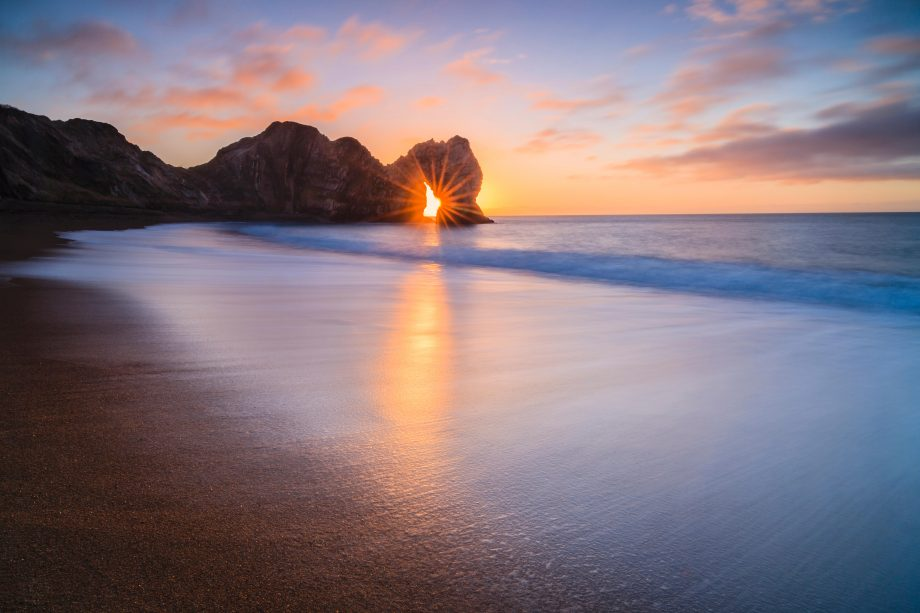 PICTURE OF THE DAY: The sun rising through the arch at Durdle Door, Dorset.