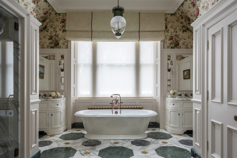 A bathroom that mixes floral, marble and fabric wall coverings to keep things fresh, pretty and unpredictable