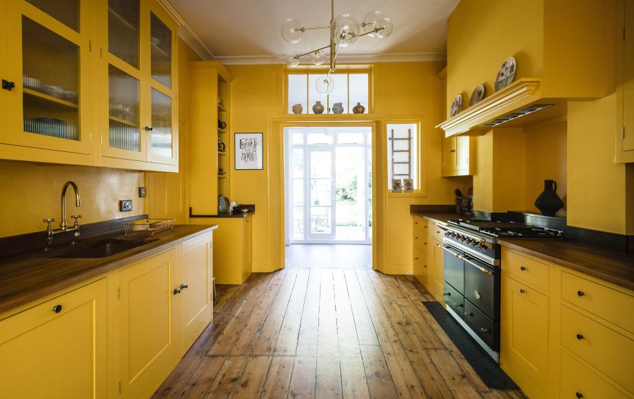 Plain English yellow kitchen design