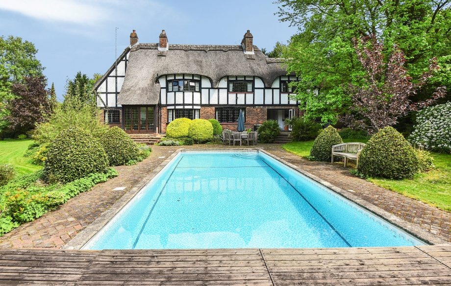 Plum Trees in Berkshire is a lovely example of a house with a swimming pool that fits beautifully into the surroundings.