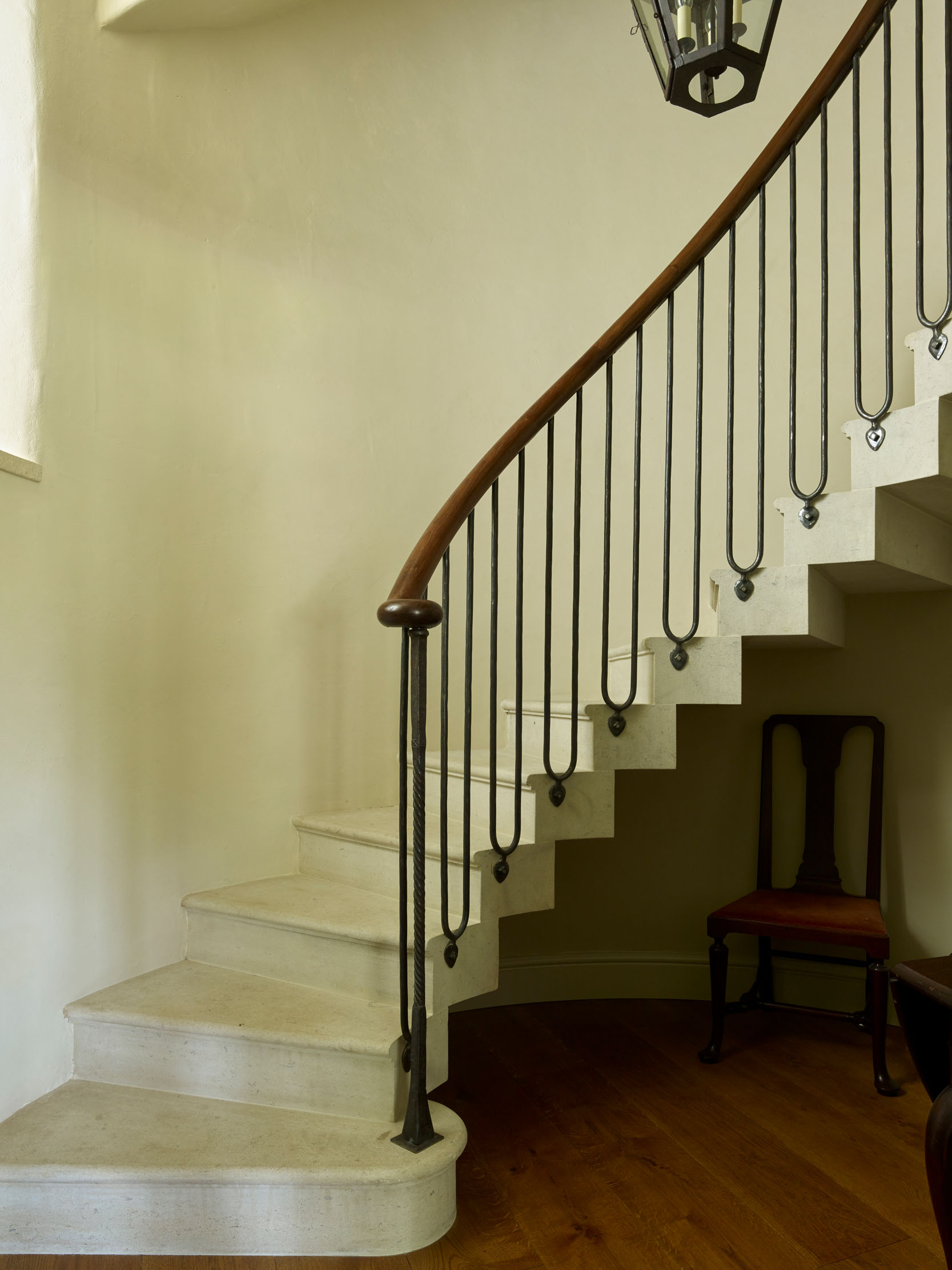Elegant simplicity: the new cantilevered staircase with ironwork baluster, part of the remodelling and extending that took place between 2014 and 2018. Credit: Paul Highnam/Country Life Library