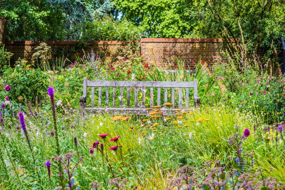 Sitting on a bench among flowers in an English country garden is restorative to the body and soul. But how?