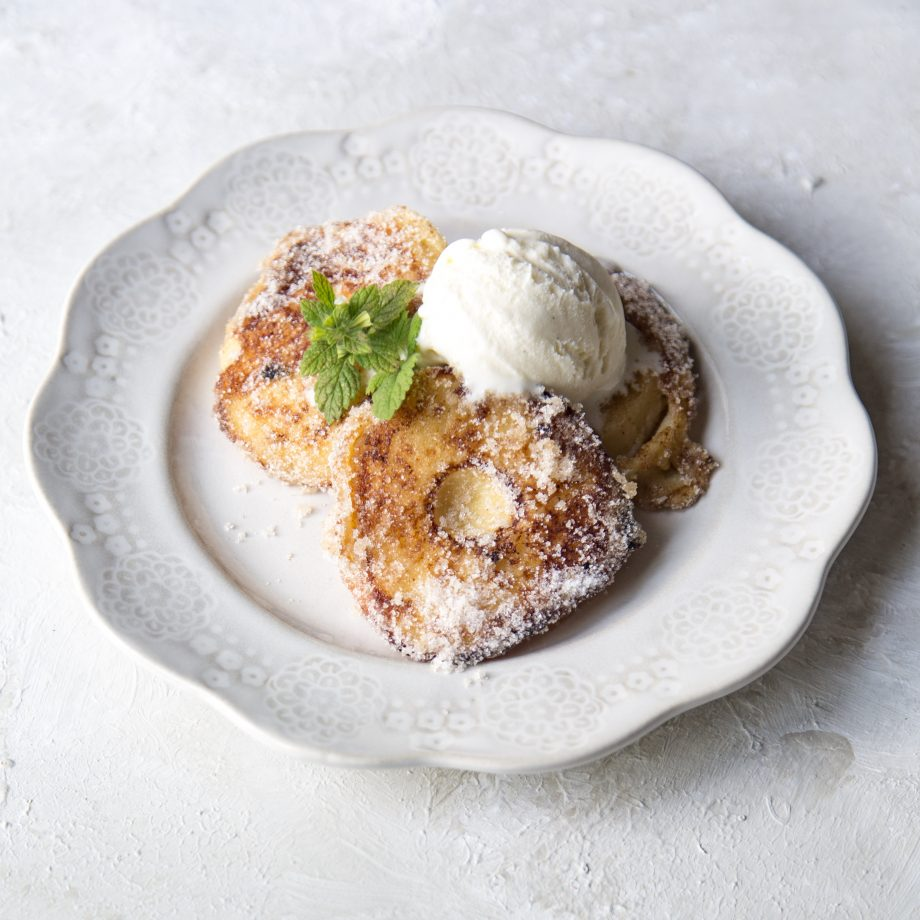 Kitchen Garden Cook Apple fritters with sugar and cinnamon.